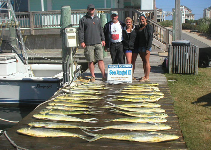 Sea Angel charter group standing behind legal limit of large mahi.